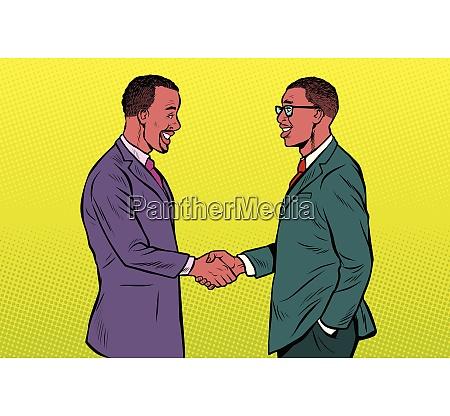 african businessmen men handshake