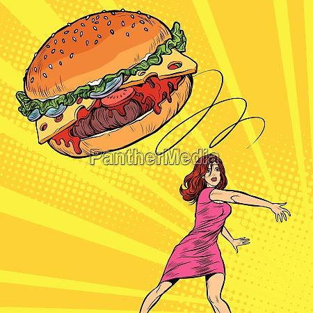 woman throws burger fast food diet