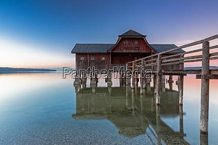 boathouse at lake ammersee at dawn