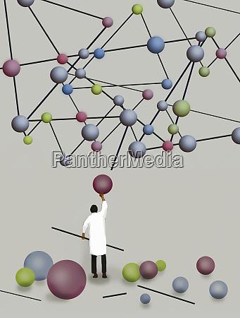 scientist struggling to build molecular model