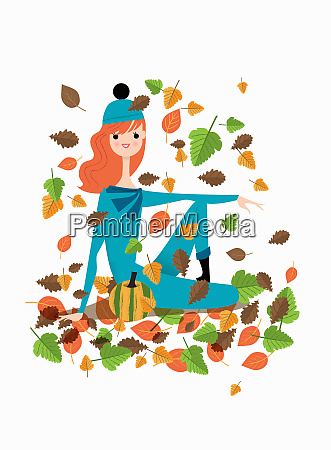 young woman sitting in autumn leaves