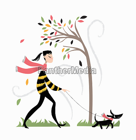woman walking the dog on a