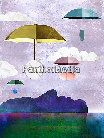 pills on umbrellas floating down to