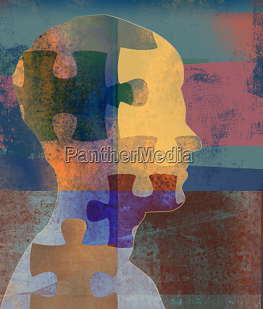 jigsaw puzzle pieces over mans profile