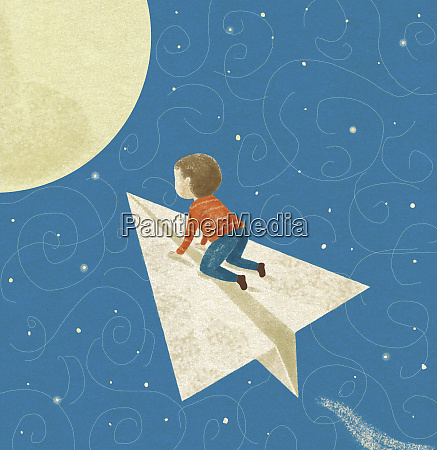 small boy flying on paper airplane