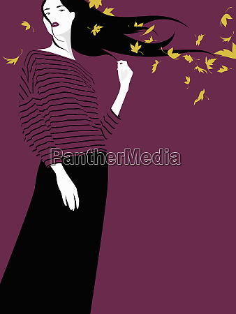 windswept woman in autumn leaves