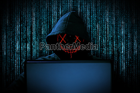 hacker with red glowing mask behind