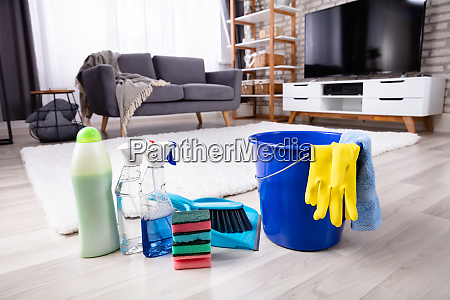cleaning products and tools on floor