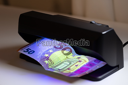 banknote and banknote detector machine on