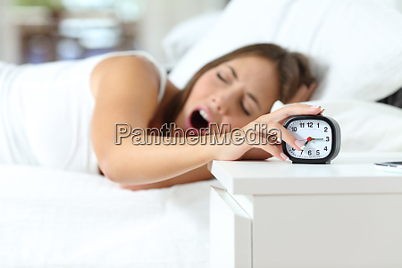 woman yawning at wakeup turning off
