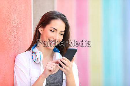happy woman using smart phone leaning