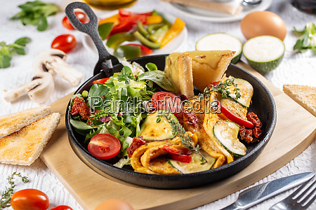 omelet served with salad