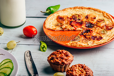 frittata with muffins over light wooden