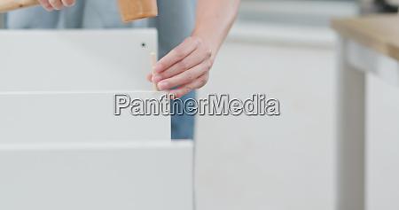 woman assembling a shelf