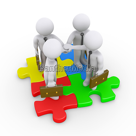 businessmen are connected with puzzle pieces