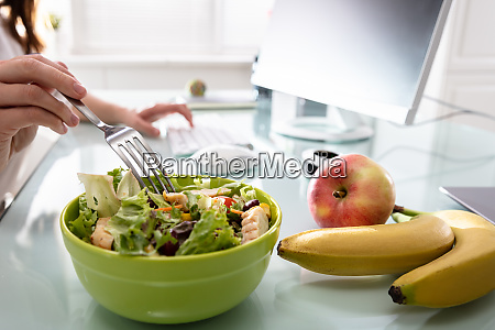 healthy salad on office desk