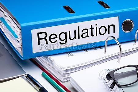 regulation folder and file on desk