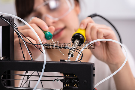 technician wearing safety eyeglasses