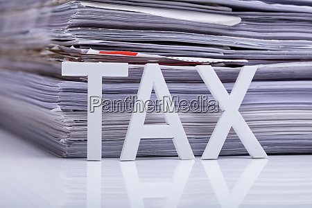 tax text in front of paper