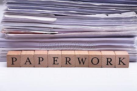 paperwork text on wooden block near