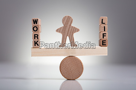 work and life block on wooden