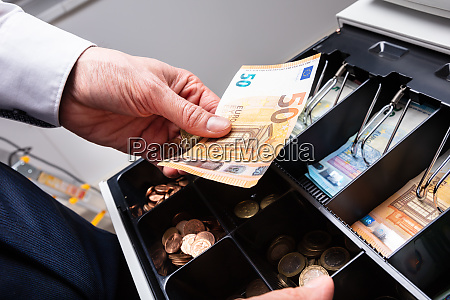 euro banknotes and coins in cash