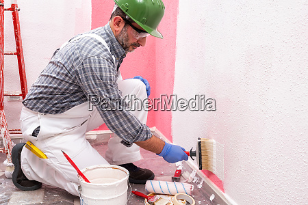 house painter worker at work in