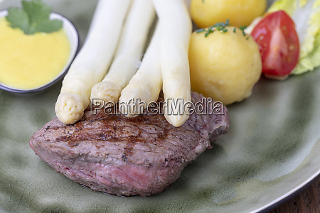 closeup of asparagus on a steak