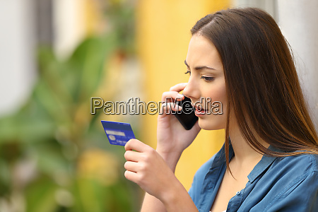 serious online buyer talking on phone