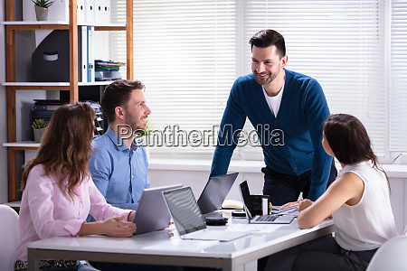 businesspeople sitting in office during meeting