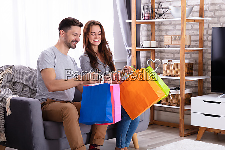 couple looking in shopping bag at