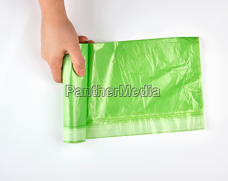 female hand unwind green roll with
