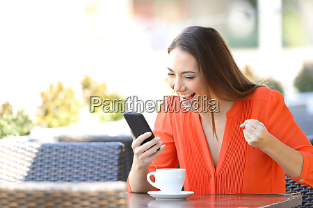 excited woman checking smart phone content