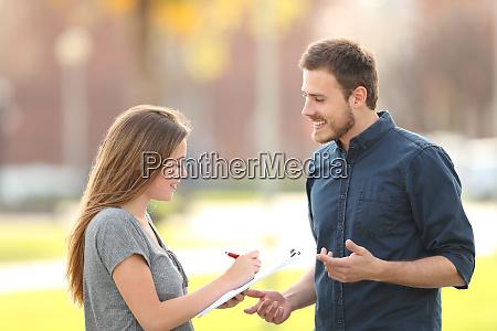 single man asking a survey in