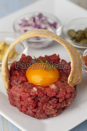 french raw minced meat called tartare