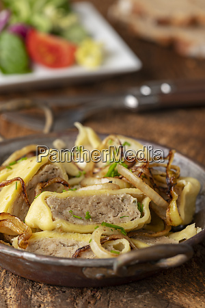 swabian maultasche with onions in a