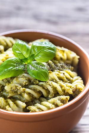 fusilli with pesto sauce on the
