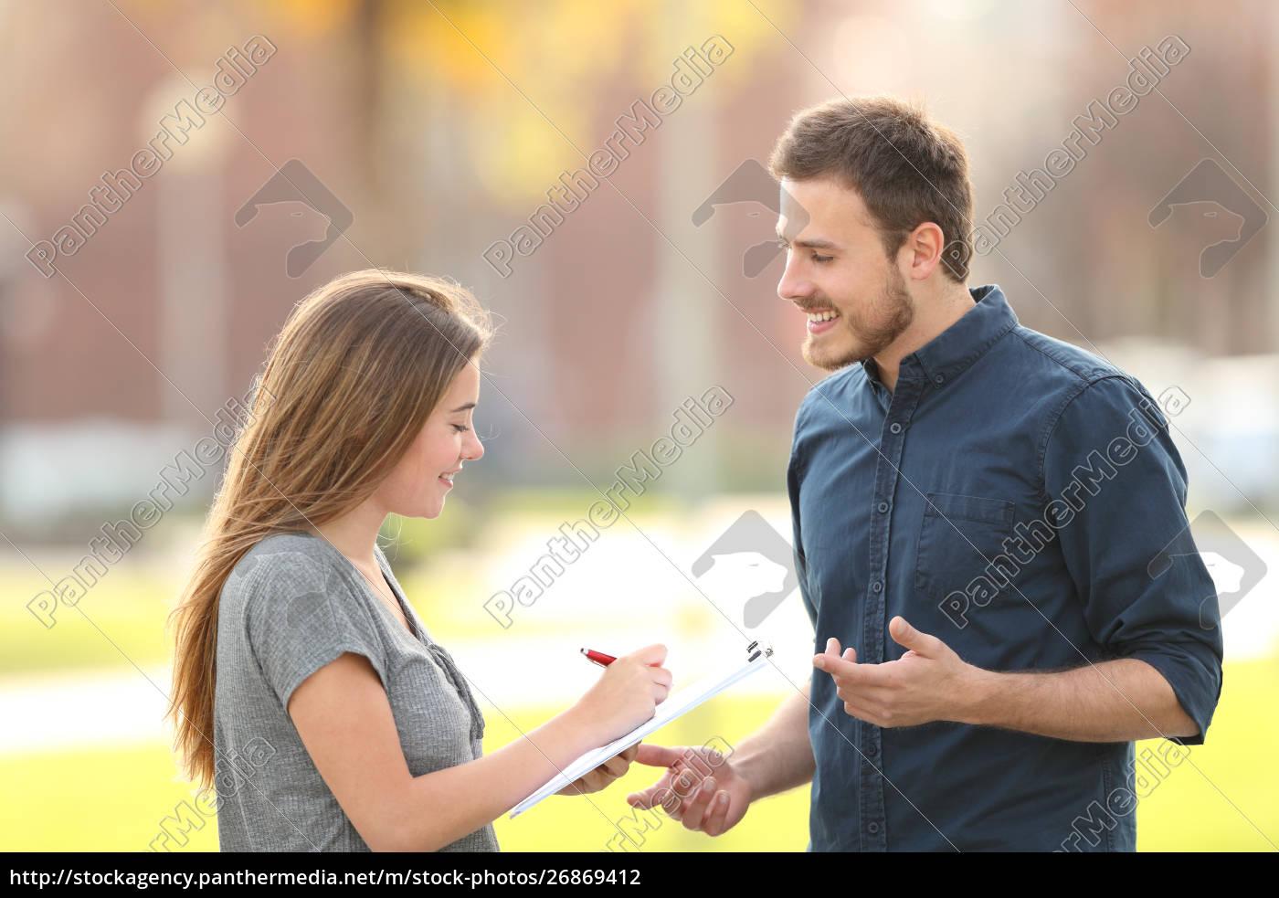single, man, asking, a, survey, in - 26869412