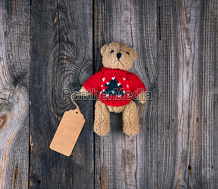 small brown old teddy bear with