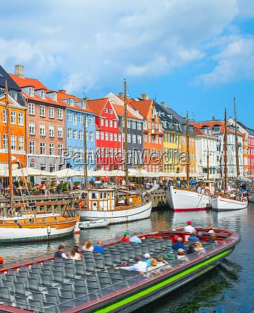 tour boat in nyhavn harbor