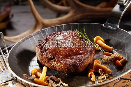 marinated wild venison deer steak with