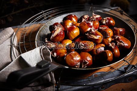 pan of freshly roasted sweet chestnuts