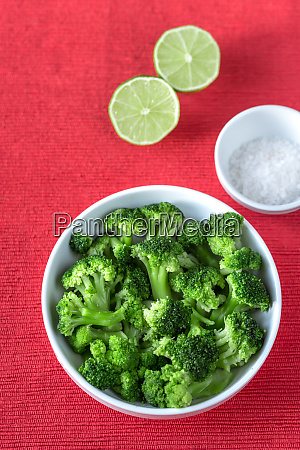bowl of cooked broccoli with seasonings