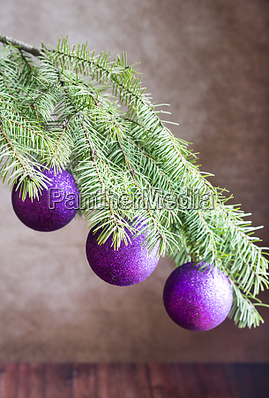 christmas tree branch with ornaments