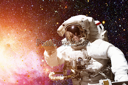 astronaut in outer space against the