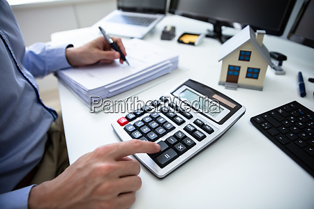 businessperson calculating property tax