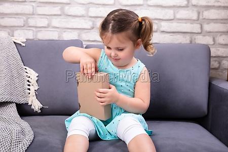 girl opening parcel box
