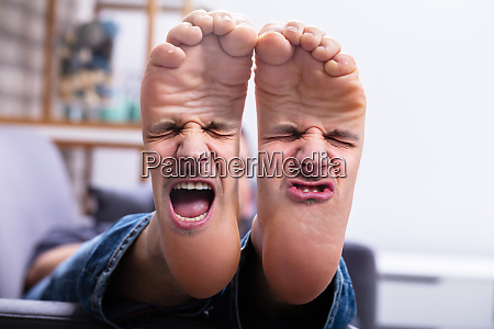 feet with painful facial expression