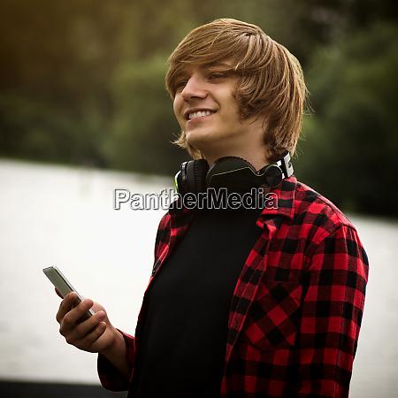 smiling teen boy with headphone