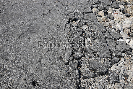 old broken road surface an old